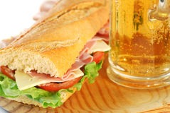 Baguette sandwich closeup with beer Royalty Free Stock Photography