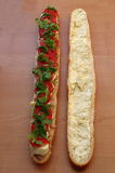 Baguette  sandwich. Baguette sandwich with egg, tomato, tone, mayonnaise and arugula Stock Photo