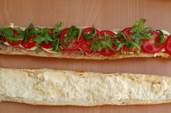 Baguette  sandwich. Baguette sandwich with egg, tomato, tone, mayonnaise and arugula Stock Photography