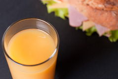 Baguette sandwich with orange juice Royalty Free Stock Photography