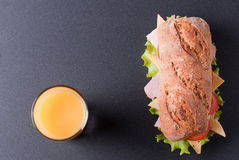 Baguette sandwich with orange juice Stock Photography