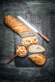 Baguette and Sandwich with shrimps on dark rustic background Royalty Free Stock Photo