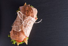 Baguette sandwich on the table top view Royalty Free Stock Image