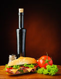 Baguette sandwich, vegetables and olive oil Royalty Free Stock Photos