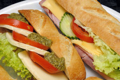 Baguette sandwiches. With lettuce, tomatoes, ham, cheese and mustard Stock Image