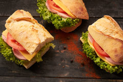 Baguette Sandwiches on the table. Baguette Sandwiches on the wooden table royalty free stock images
