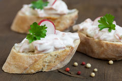Baguette with sausage salad. And fresh herbs Stock Images