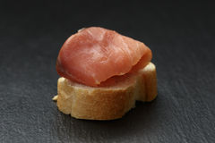 Baguette slice with curred salmon on slate Royalty Free Stock Photo