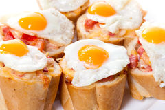 Baguette Slice with Ham and Fried Quail Egg Royalty Free Stock Photos