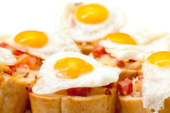 Baguette Slice with Ham and Fried Quail Egg Stock Photography