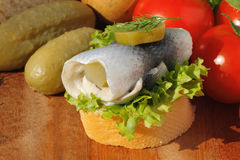 Baguette slice with sour herring, pickled herring Royalty Free Stock Image