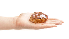 Baguette slice spread with nut-choco paste in female hand Stock Photography