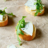 Baguette slices with blue cheese Stock Images