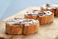 Baguette slices with chocolate hazelnut spread on Royalty Free Stock Image