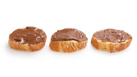 Baguette slices spread with nut-choco paste Royalty Free Stock Photos