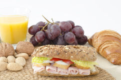 Baguette and some ingredients on a table Stock Photography