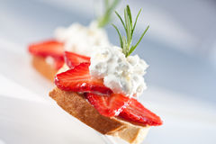 Baguette with strawberries and goat cheese Royalty Free Stock Photo