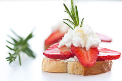 Baguette with strawberries slices and goat cheese Royalty Free Stock Photography