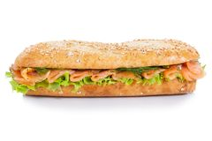 Baguette sub sandwich whole grains with salmon fish lateral isol Stock Image