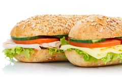 Baguette sub sandwiches ham and cheese closeup isolated on white royalty free stock photo