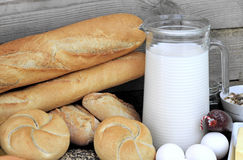 Baguette and various breads and foods on Wall background Stock Photos