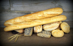 Baguette and various breads on Wall background Royalty Free Stock Photography