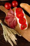 Baguette among vegetable ham and grains Stock Images