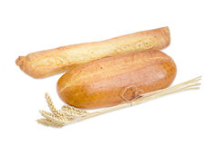 Baguette, wheat bread and bundle of wheat ears Royalty Free Stock Photography