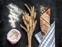 Baguette, wheat and flour on black chalkboard Royalty Free Stock Image