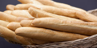 Baguette white bread in the basket Royalty Free Stock Images