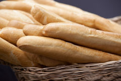 Baguette white bread in the basket Stock Photos