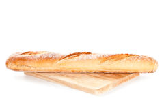 Baguette on the wooden board Royalty Free Stock Photo