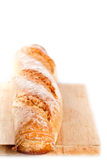 Baguette on the wooden board Stock Photos