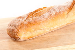 Baguette on the wooden board Royalty Free Stock Photos
