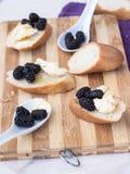 Baguette on a wooden board. Sliced bread, baguette on a wooden board Stock Photos