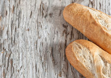 Baguette on the wooden board Stock Photo