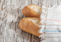 Baguette on the wooden board Stock Photography