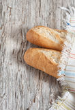 Baguette on the wooden board Stock Images