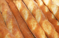Baguettes behind a window. Variety of loaves of french bread on shelves in a bakery behind a window Stock Photo
