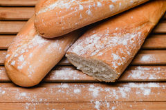 Baguettes on the board. Sliced baguettes on the board Royalty Free Stock Photos