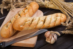 Baguettes. Lying on a wooden chopping board Stock Images