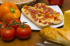 Baguettes with pepperoni and ingredients stock images