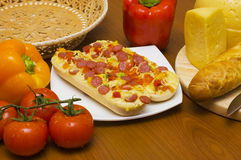 Baguettes with pepperoni and ingredients Stock Photography