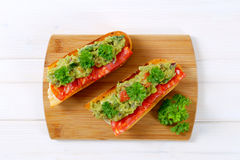 Baguettes with salami and guacamole Royalty Free Stock Images