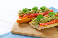 Baguettes with salami and guacamole Stock Photo