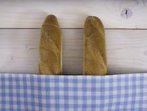Baguettes sob um lenço Imagem de Stock Royalty Free