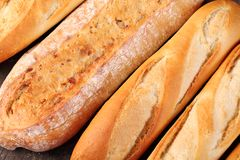 Baguettes. Top view of baguettes on wooden background stock photos