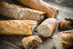 Baguettes on the wooden background Royalty Free Stock Image