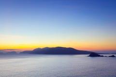 Bahía de Dunquin en Co. Kerry en la puesta del sol Fotografía de archivo libre de regalías