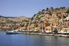 Bahía de Gialos en Ano Symi Grecia Foto de archivo libre de regalías